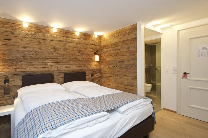 Kleines Doppelzimmer Süd Chalet Stil